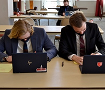 Debaters take two national championships in PKD tourney